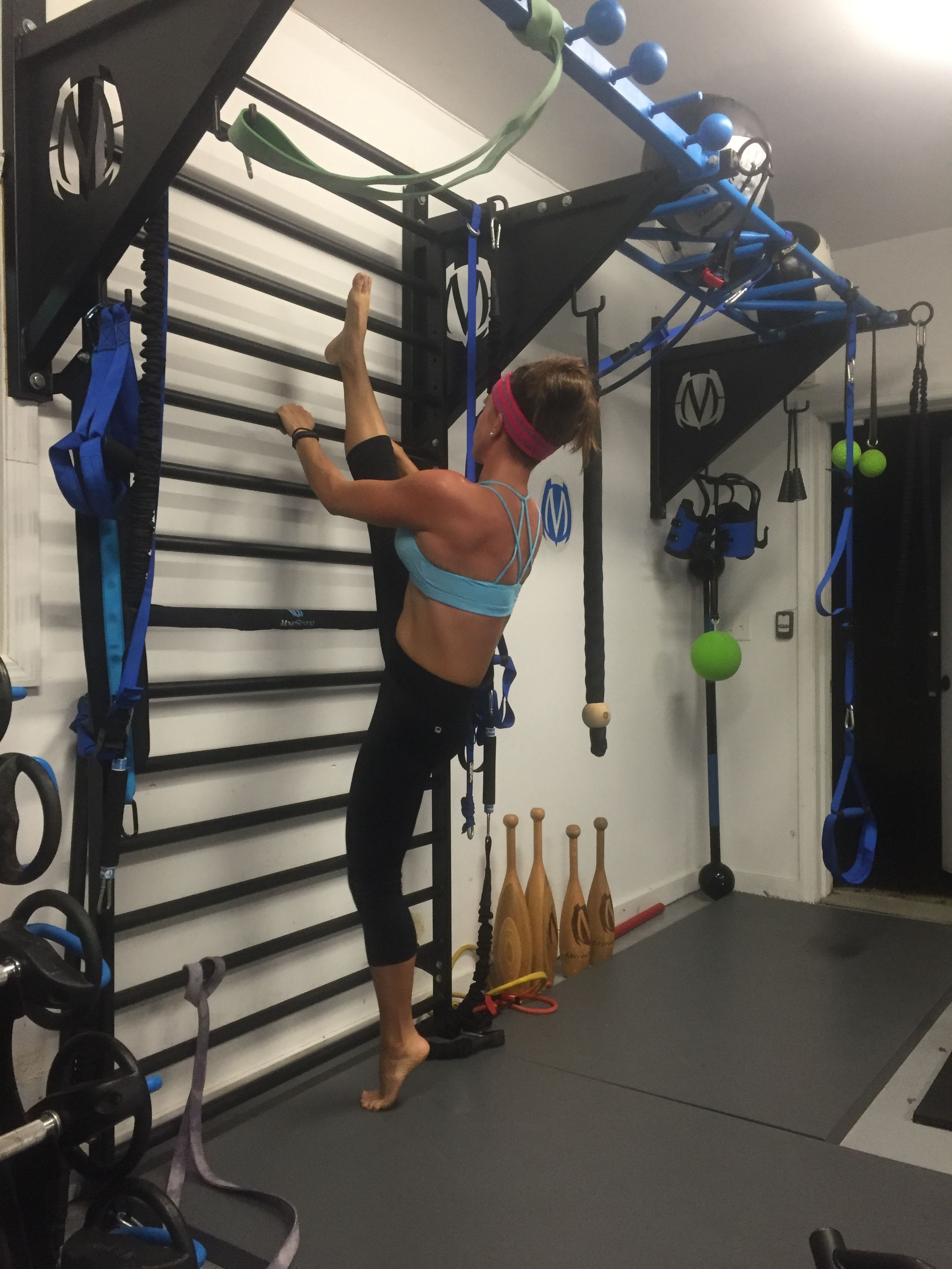 Standing split on the movestrong stall bars for mobility