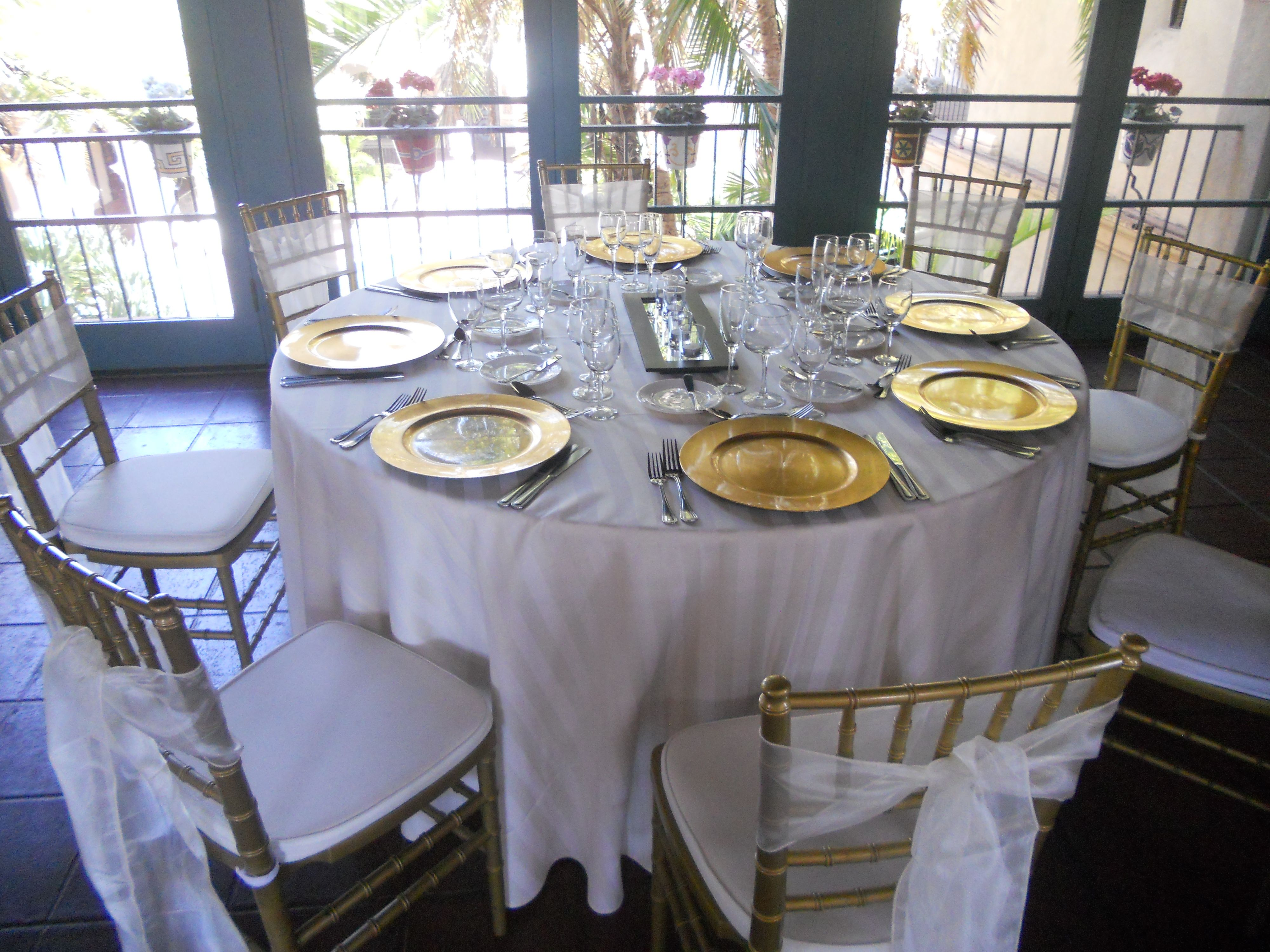 Black and white stripe charger plates - White Striped Linen With Gold Charger Plates