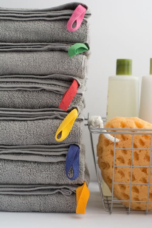 Diy color coded towels assign a color to each family Bathroom hand towels with hanging loops