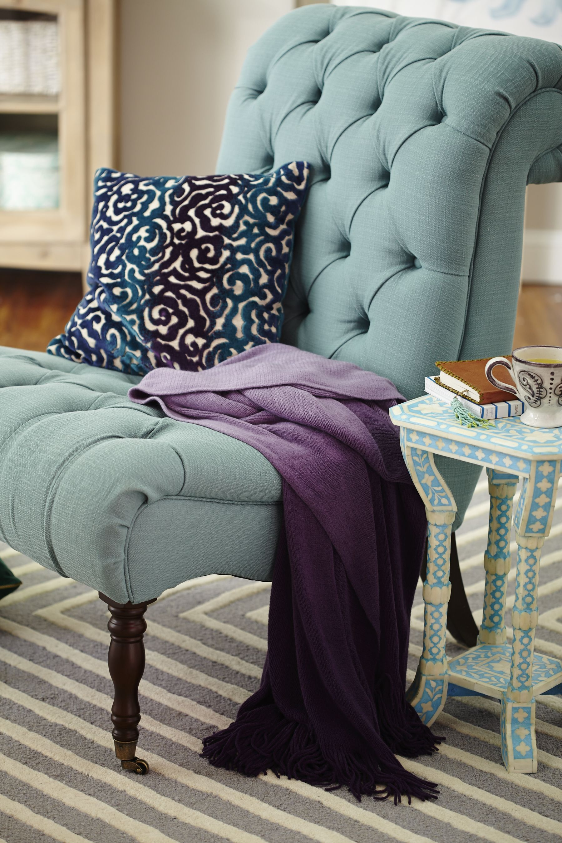 Sitting pretty at a perfect price is #HomeGoodsHappy!  Any corner of your home can turn into your favorite nook with a pretty tufted chair, detailed pillow and ombre throw. Find more design inspiration on our blog!