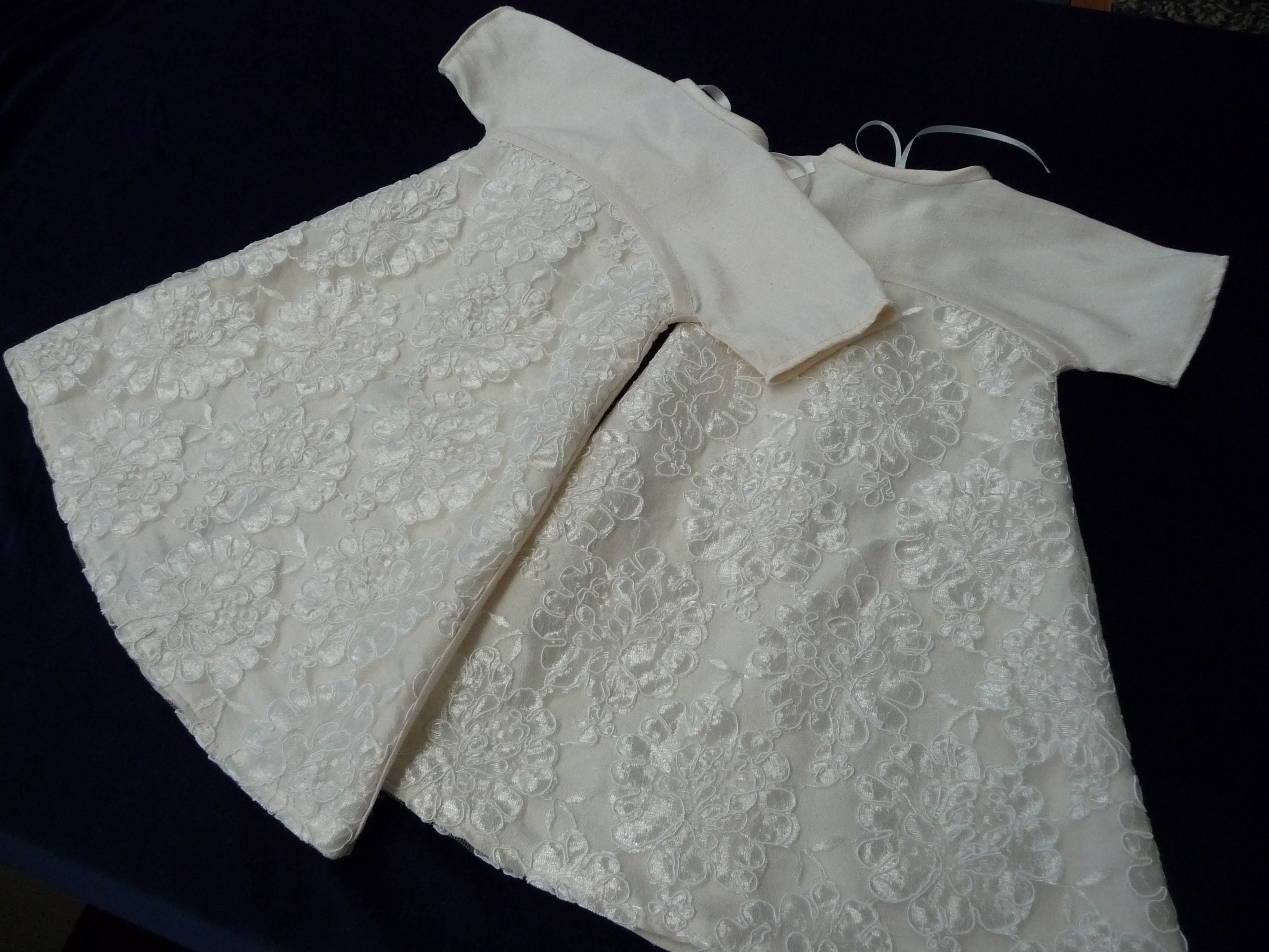 Two Angel gowns made from raw silk fabric with lace overskirt.