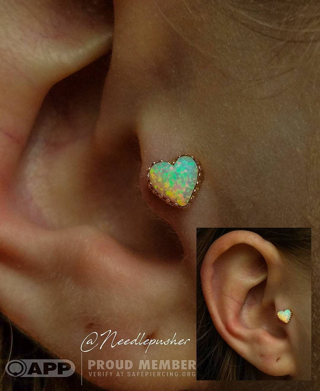 Fresh tragus piercing using this lovely white opal heart from @anatometalinc for the awesome Katie! (Disclaimer it is a white opal the light was just working against me and caused it to look yellow) #traguspiercings #piercedears #cartilagepiercings...