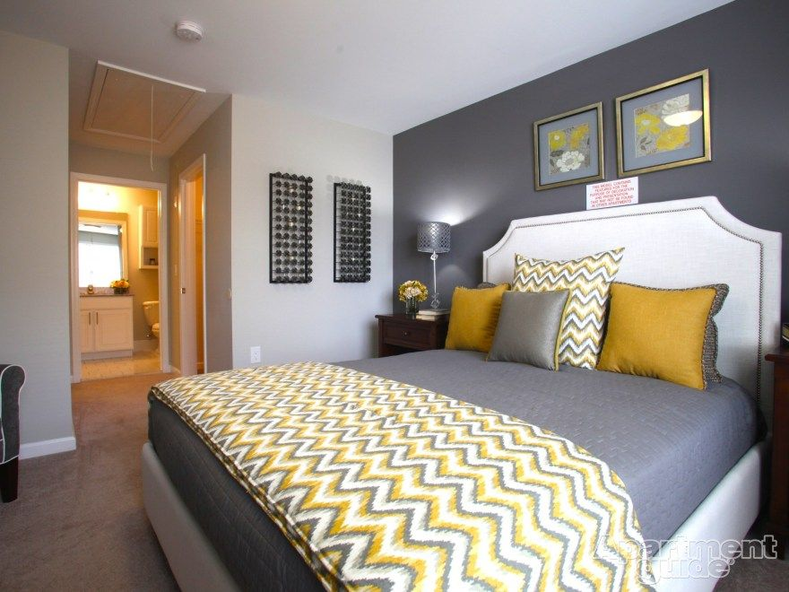 We love this yellow gray palette in this bedroom for Bedroom designs black and grey