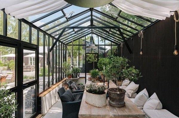 wintergarten pflanzen pflege glasdach sonnenraum alu schwarz ...