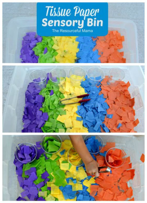 This tissue paper sensory bin is set up to allow children to strengthen fine motor skills by using the tongs to sort and match the tissue paper into cups.