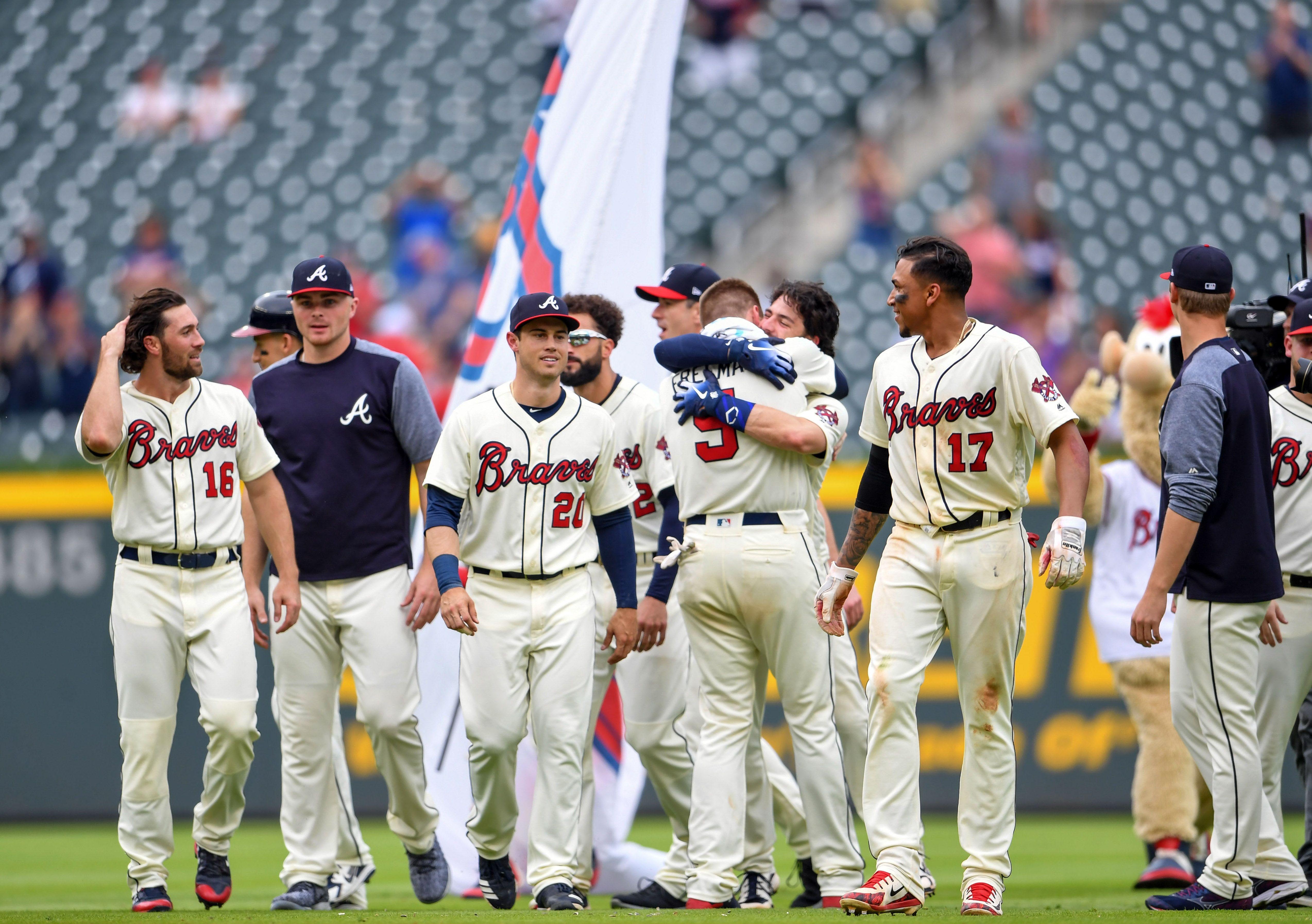 May 20 2018 Atlanta Ga Usa Atlanta Braves Shortstop Dansby Swanson 7 Hugs First Baseman Freddie Freeman 5 Braves Major League Baseball Usa Today Sports