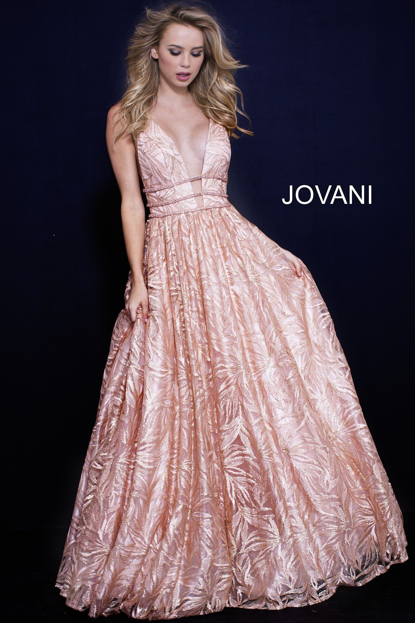 3b850cf64cb Shimmer under the moonlight in Jovani 51439. This enchanting ball gown  blooms with a shimmering sequin floral print. The bodice has a deep plunge  neckline