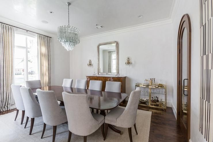 Chic Dining Room Features A Blue Glass Tiered Chandelier Beauteous Rectangular Dining Room Chandelier Design Inspiration