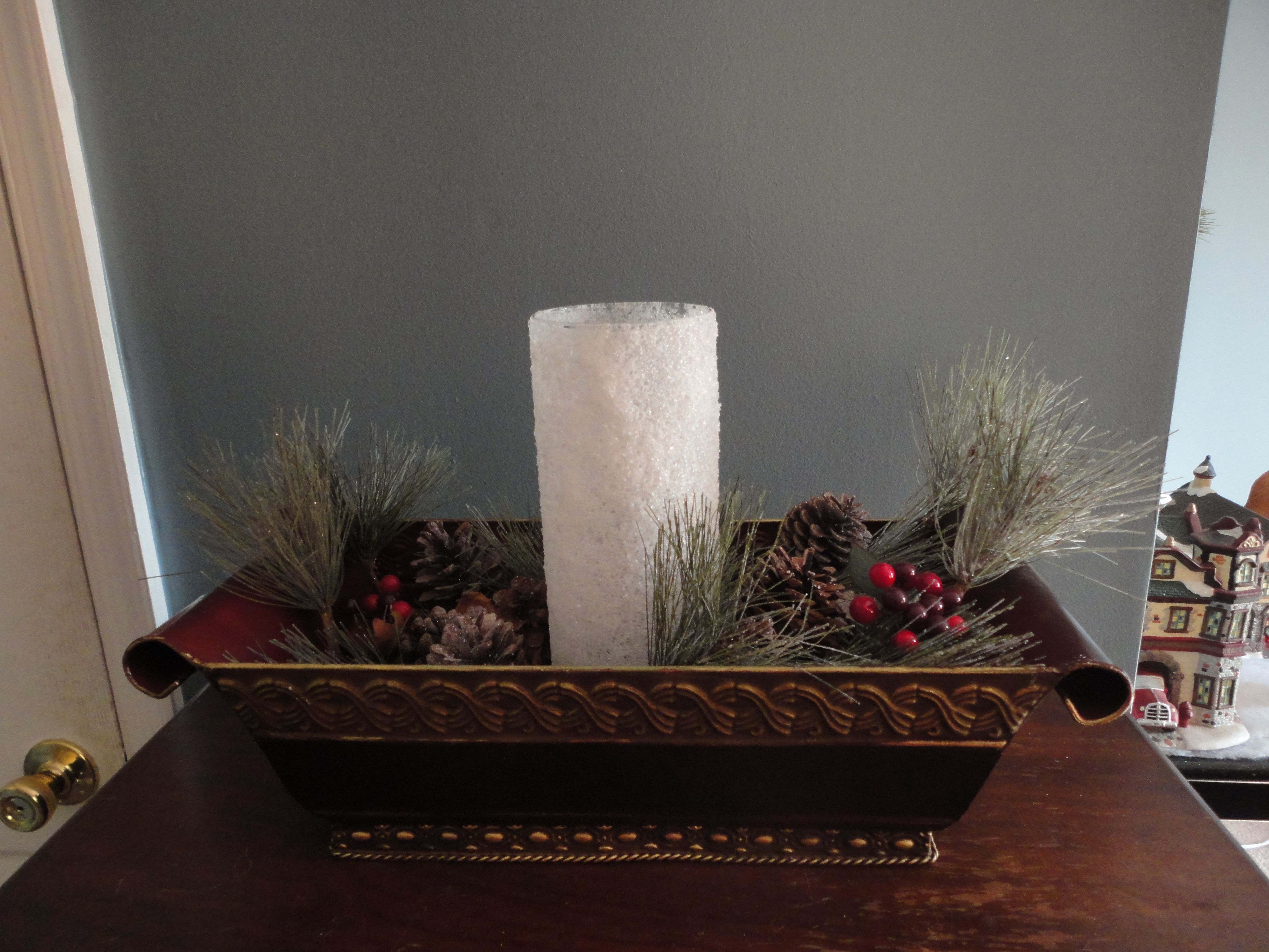 """The metal planter gave me the impression of a sleigh with it's rounded sides.  I added pinecones, greenery and berries, and then put a """"snowy"""" treatment on a tall cylinder candle holder. etsy.com/shop/holidaypretties"""