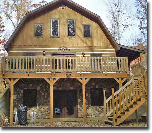 Barn home farm house with rap around deck and balcony for Two story barn house plans