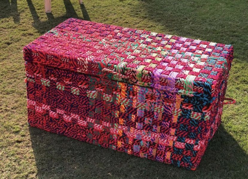 Made from the upcycled cloth rags from the multicoloured skirts and dupattas of Rajastani aristocracy and royalty, this Bano chequered weave box boasts a roomy interior that can store a large number of items. It is also a sight for sore eyes as one cas see, so it can be used as a decorative piece. #wastetowow #wovenfurniture #vintagefurniture #charpoy #charpai #weaversofinstagram #sustainableliving #sustainabledesign #circulareconomy #circularfurniture #supportyourladies #surviveandthrive #susta