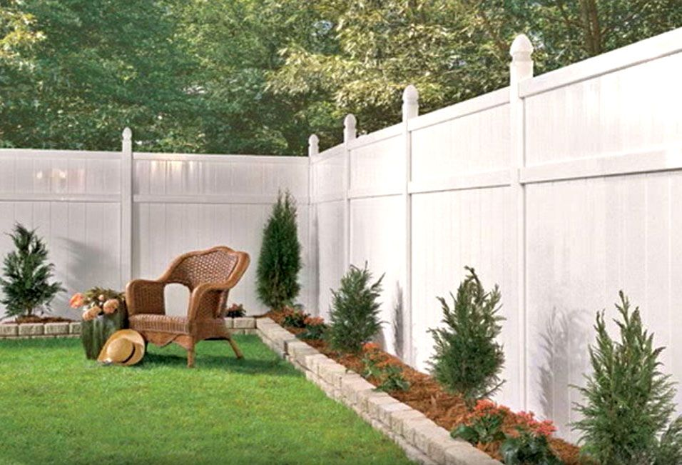 White vinyl fence with a small raised border very cute for Small front yard ideas with fence