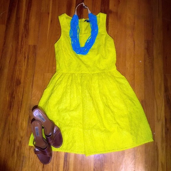 Cheery yellow fit and flare in eyelet cotton. This dress is perfect for spring and summer.  It's lightweight and flouncy, and the cotton material is durable and easy to care for!  Pre-owned, in good condition. Old Navy Dresses Midi