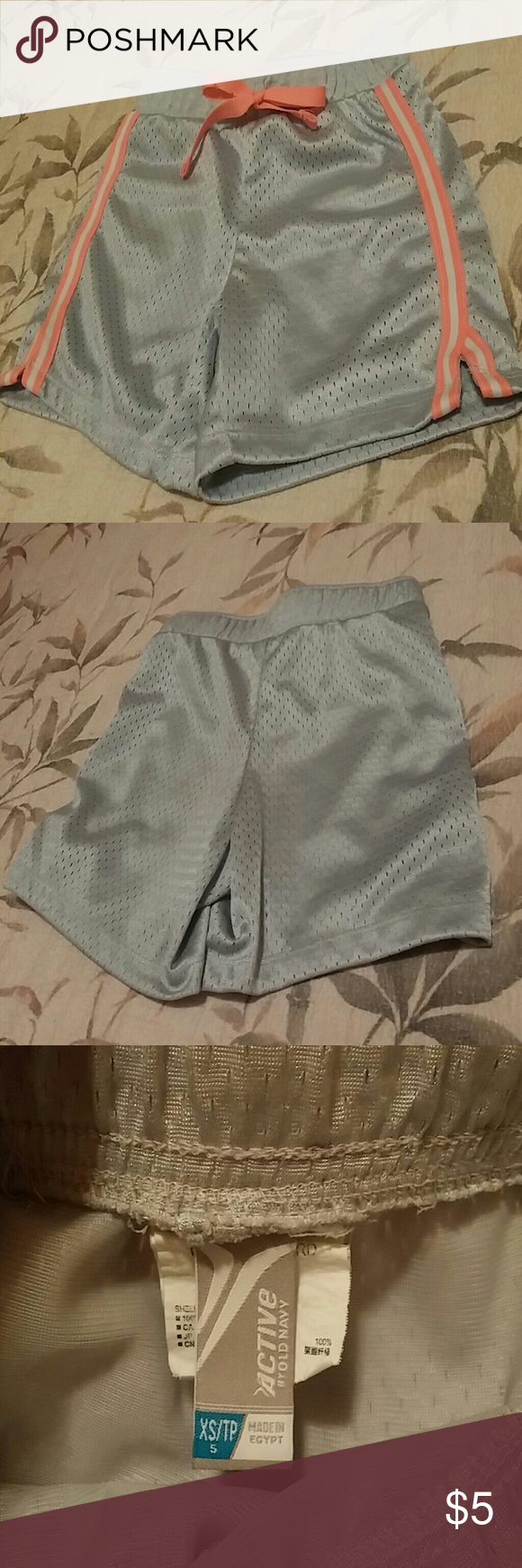 Old Navy girls athletic shorts Old Navy girls gray athletic shorts with a pink and white stripe down each leg and a pink drawstring tie at waist. Old Navy Bottoms Shorts