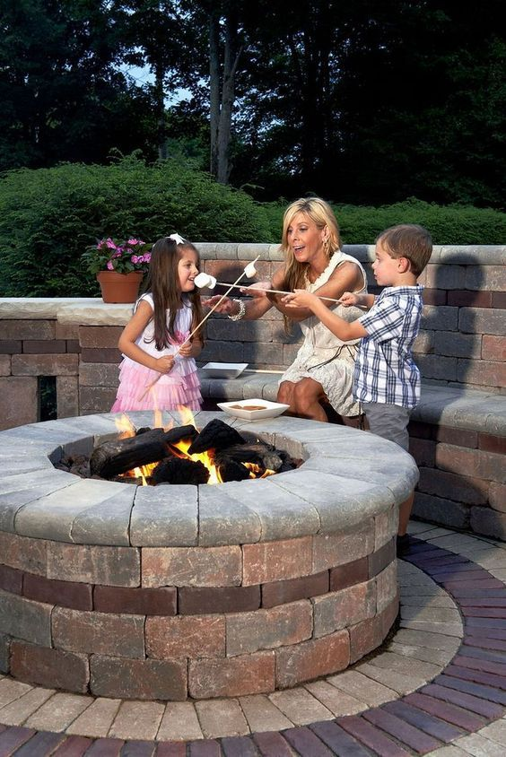 Sunset Fire Pit From Unilock With A Custom Cap Add In A Gorgeous Seating Wall And Circular Patio And You Ve Got A Fant Outdoor Fire Fire Pit Outdoor Fire Pit