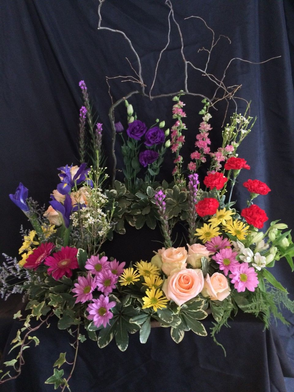 A wreath made for a funeral. The center is left open for
