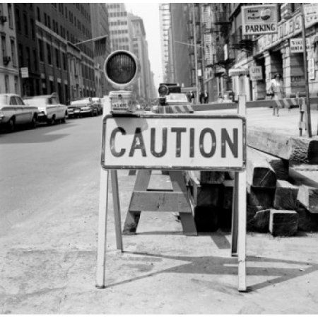 Caution sign on city street Canvas Art - (18 x 24)