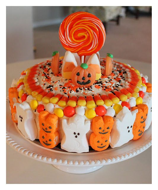 Halloween cake with frosting, sprinkles, Peeps, candy corn, MM\u0027s
