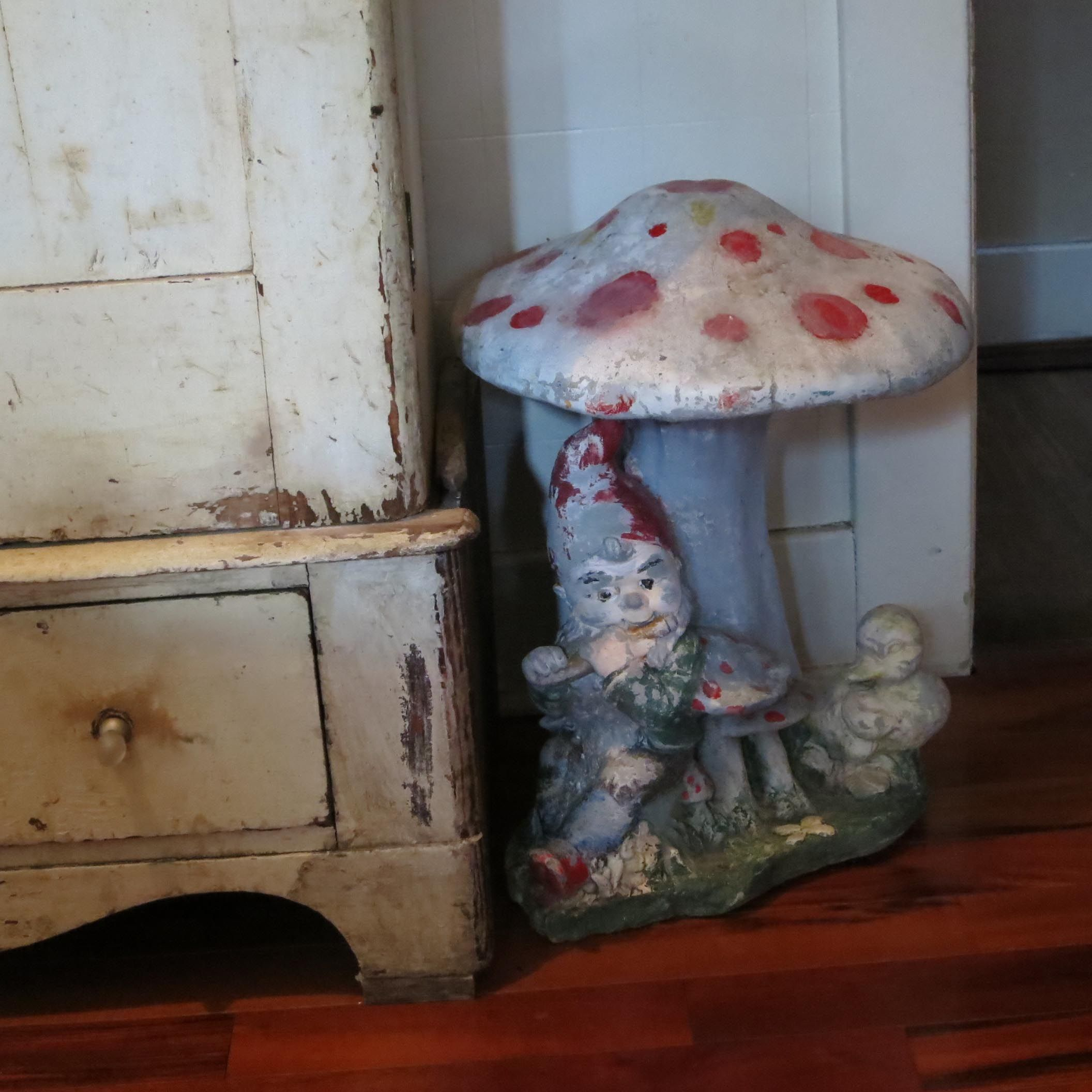 cement garden gnome and mushroom