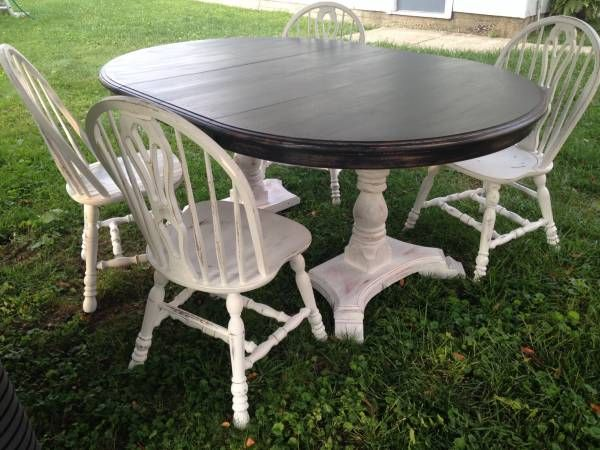 table top has been refinished with black chalk paint and