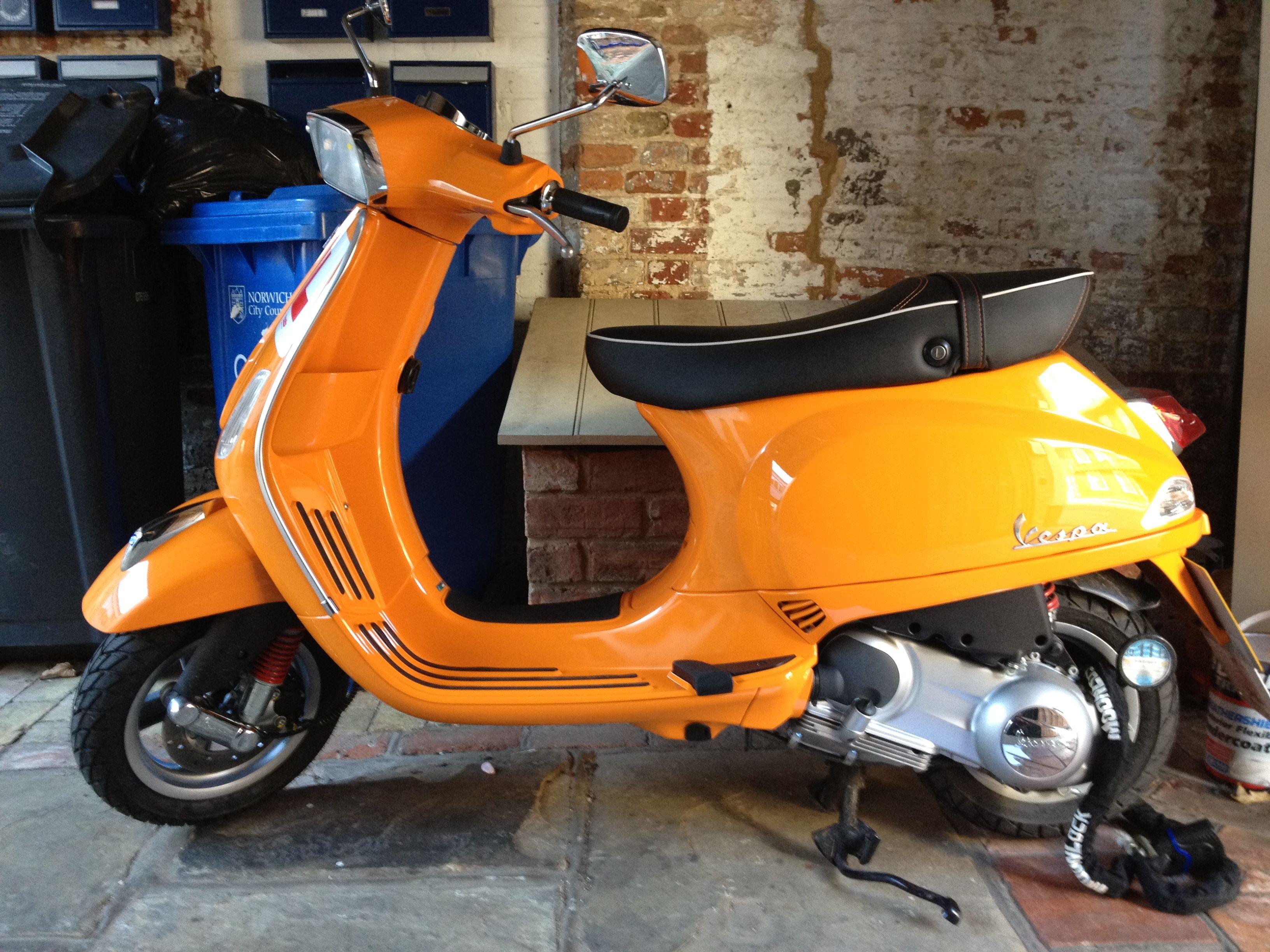 My vespa s125 in subtle orange