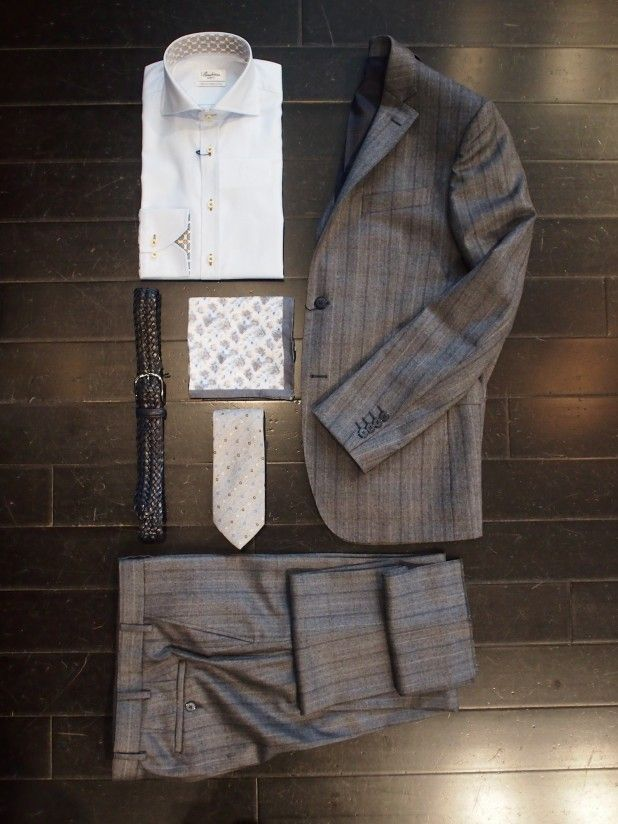 Strenstroms Fine Gingham Slimline Shirt: $258 Lab Stripe Grey Suit: $1110 A Christensen Tie: $95 A Christensen Linen Pocketsquare: $45 Andersons Braided Belt$ 175