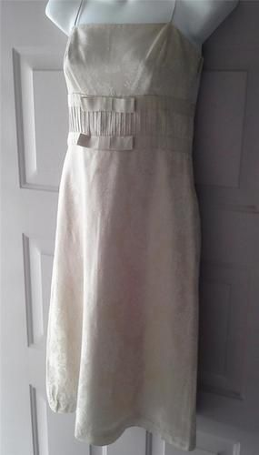 ANN TAYLOR LACE PRINT EMPIRE WAIST SLIP DRESS ~  size 0  Dress is a pale beige/gold color with a lace print on the fabric.  Fully lined   Spaghetti Straps  Double ribbon trim below the bust. Hidden side zipper with a hook  eyelet closure