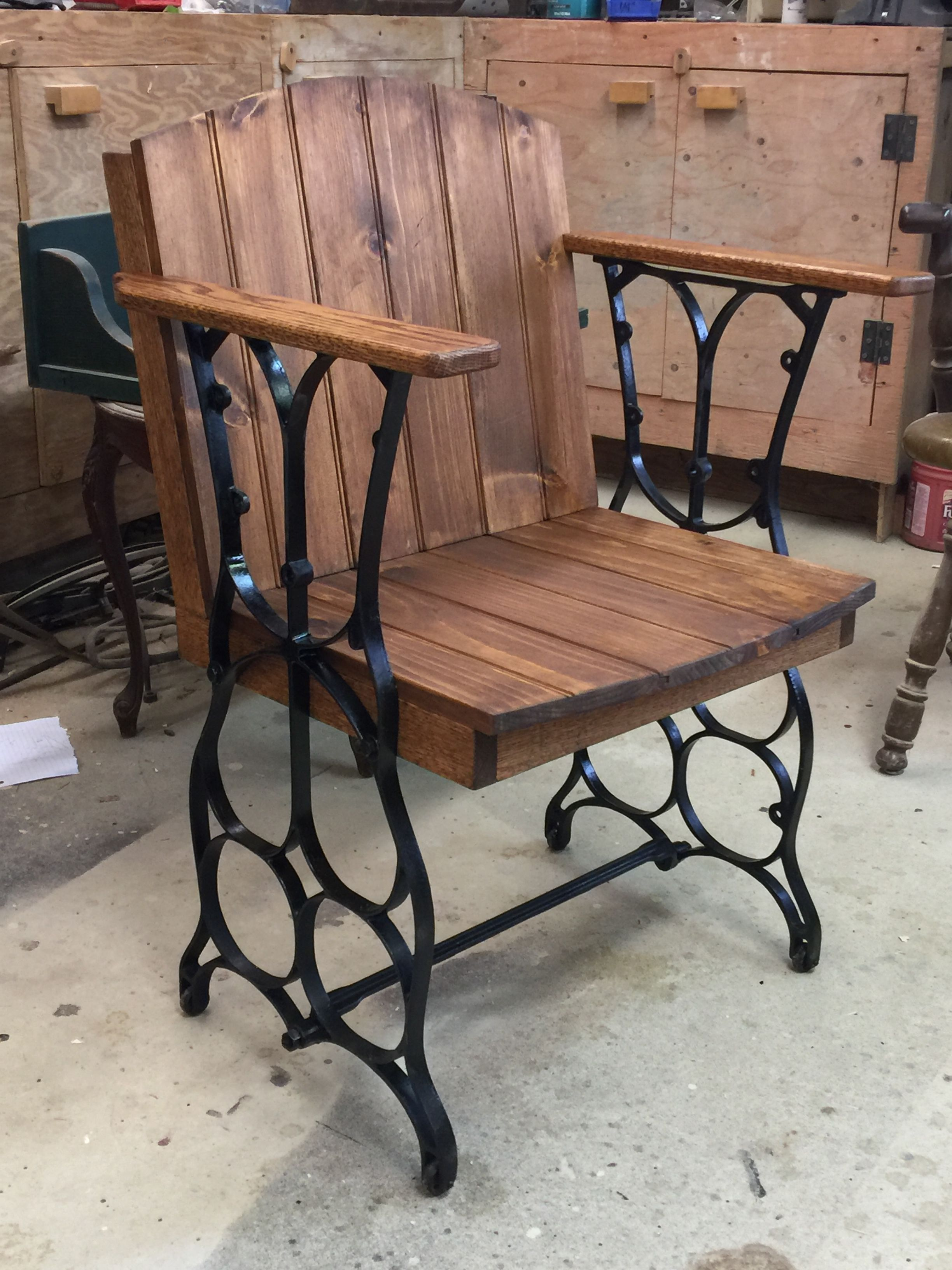 I made this chair from an old set of treadle sewing machine legs