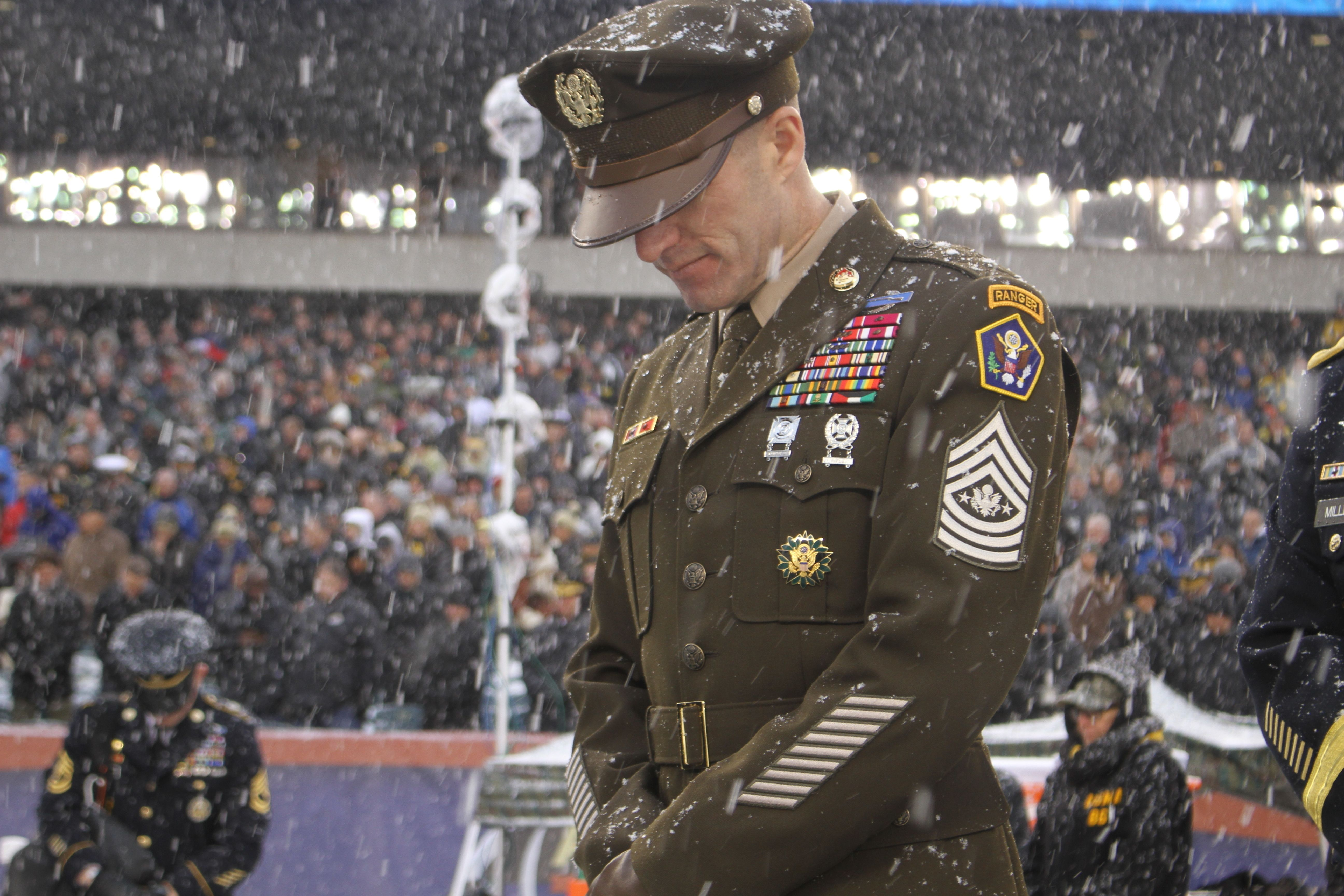 Sergeant Major of the Army Dan Dailey bows in prayer prior