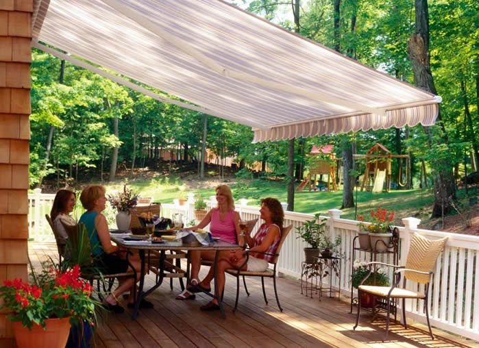 Dinner on the back deck under a motorized awning by http://KellyWindowAndDoor.com/