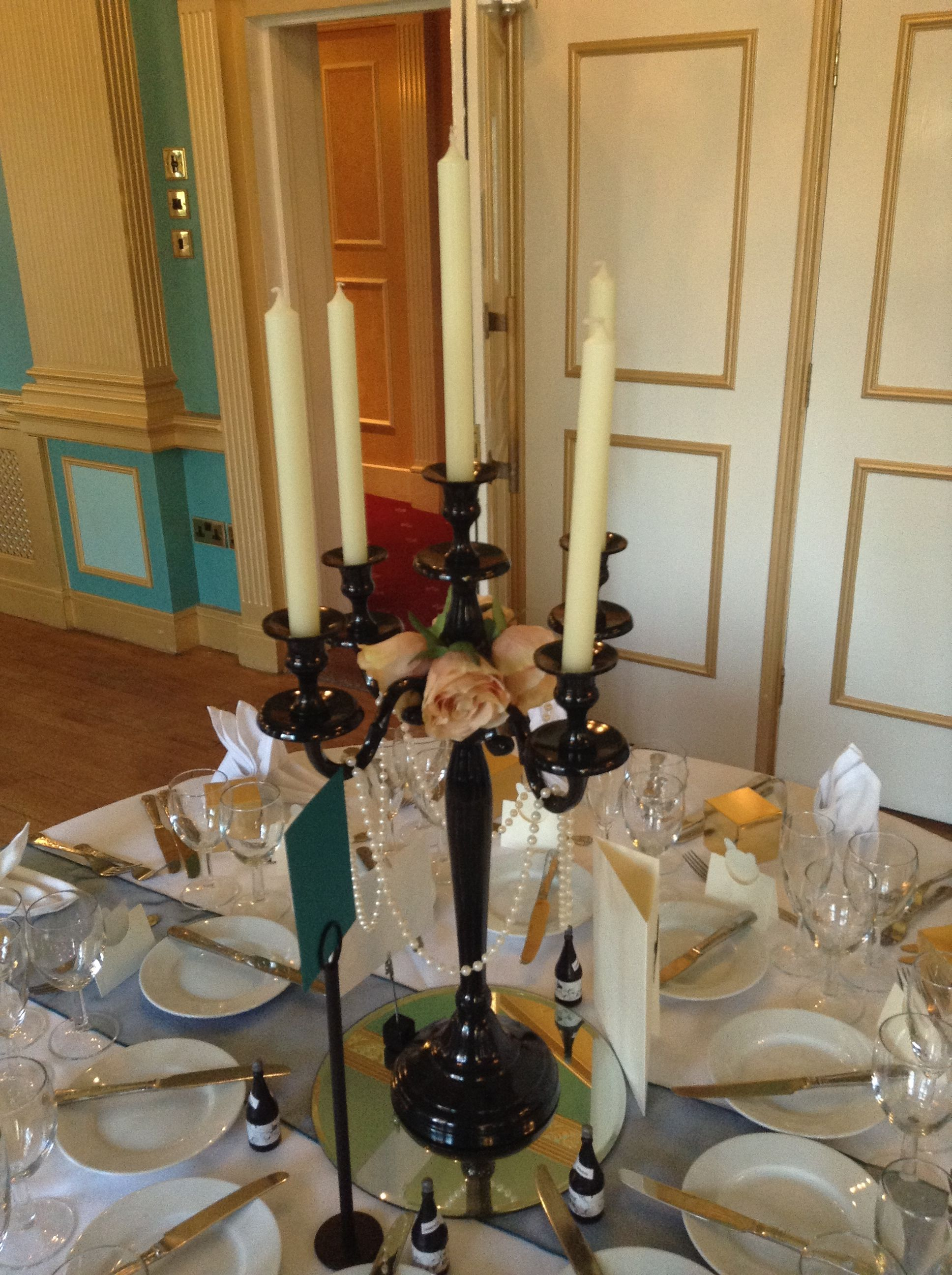 Black Candelabra With Champagne Roses And Pearl Strings