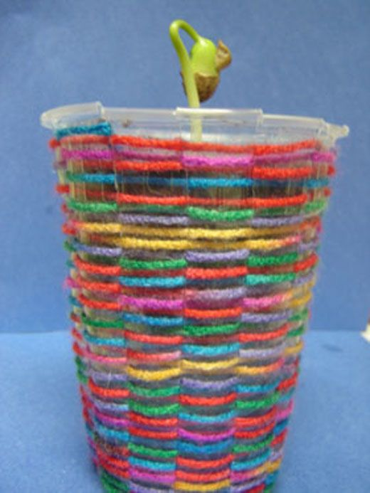 Woven plastic cup seedling planter.  This tutorial shows kids how to plant the pinto bean in a plastic cup and then weave yarn onto a second cup to hold the seedling cup.  Easy, great project!