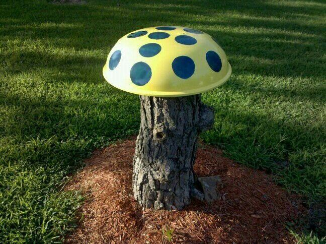 Tree Stump And Old Grill Top Painted To Make Yard Mushroom.