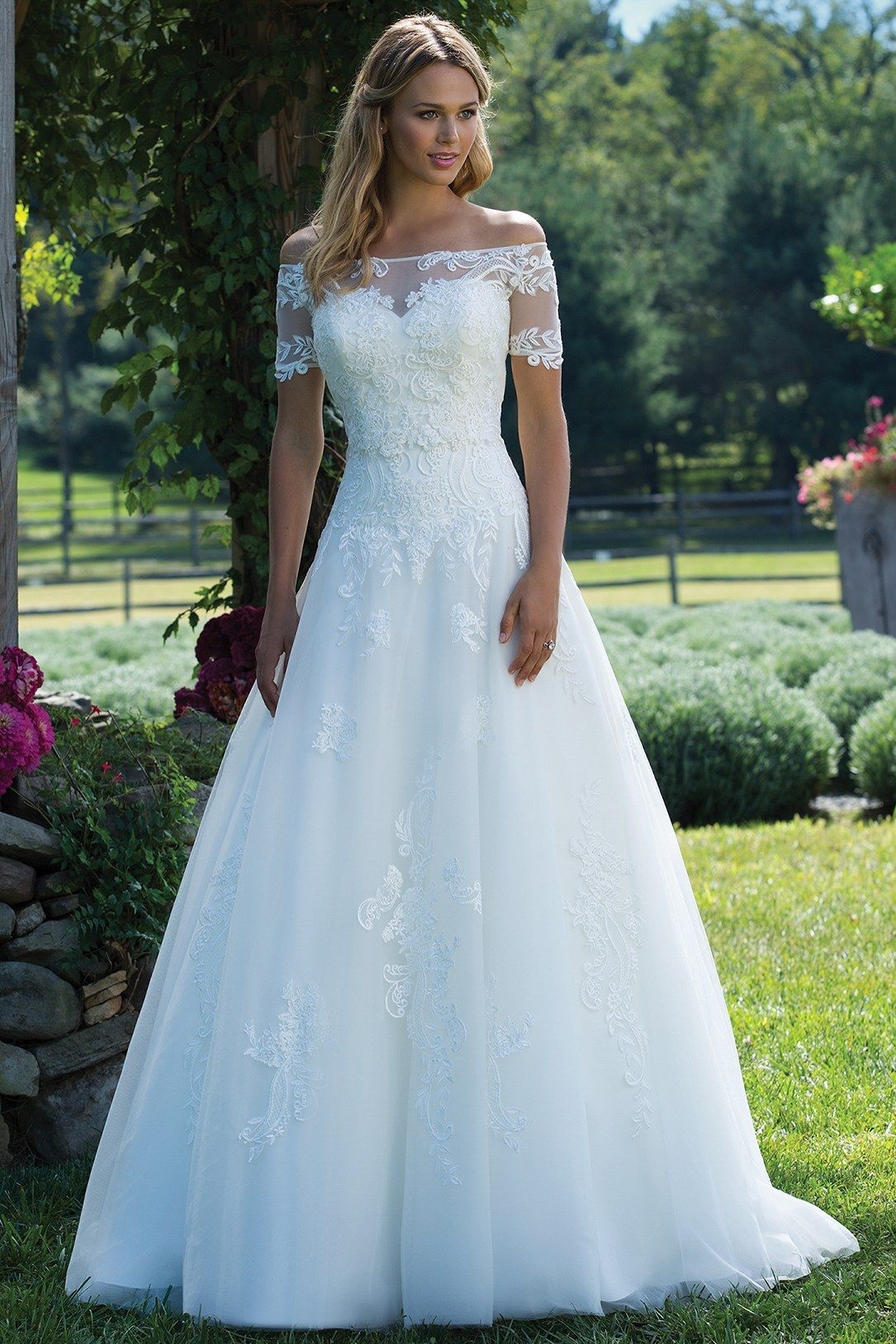 A corseted sweetheart wedding ball gown with allover lace. The full ...
