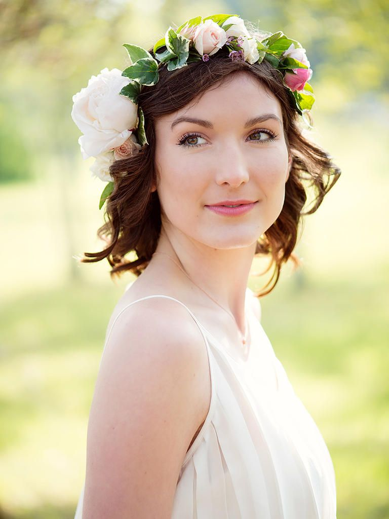 2024d8b8411c5 You ll look dreamy in this short curly wedding hairstyle with an ivy and rose  flower crown.