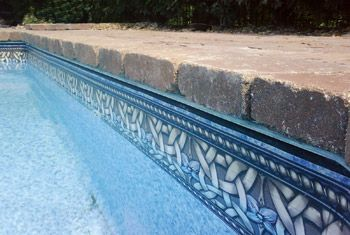 photo of vinyl liner pool with paver brick coping