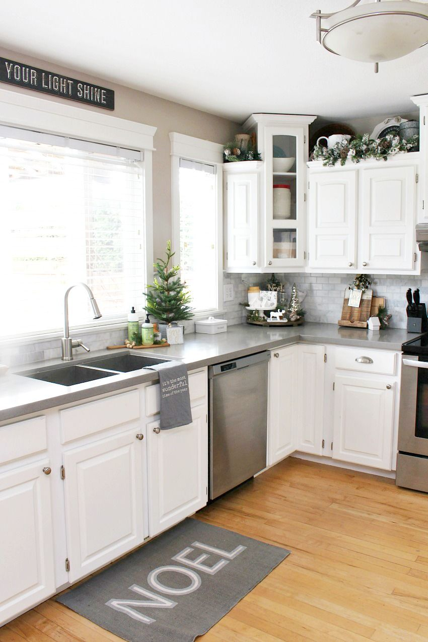 kitchen christmas decorations white kitchen dressed in frosted greens for a festive touch - Pinterest Christmas Kitchen Decorating Ideas