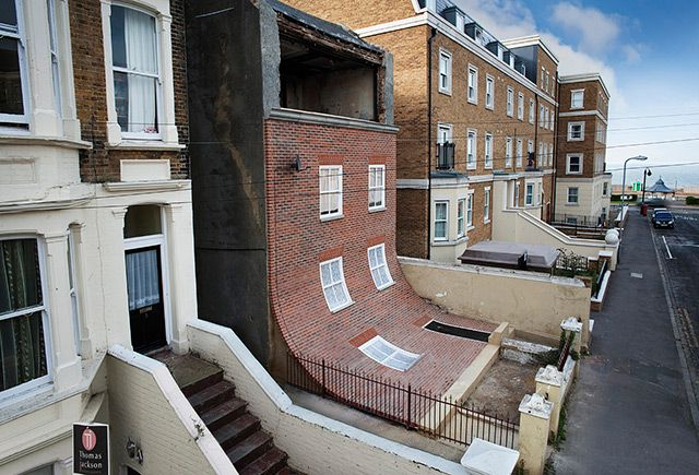A Brick Facade Appears to Melt Off of an Apartment Building in Margate.   How fun is this!? See more on Colossal:  http://www.thisiscolossal.com/2013/10/building-alex-chinneck