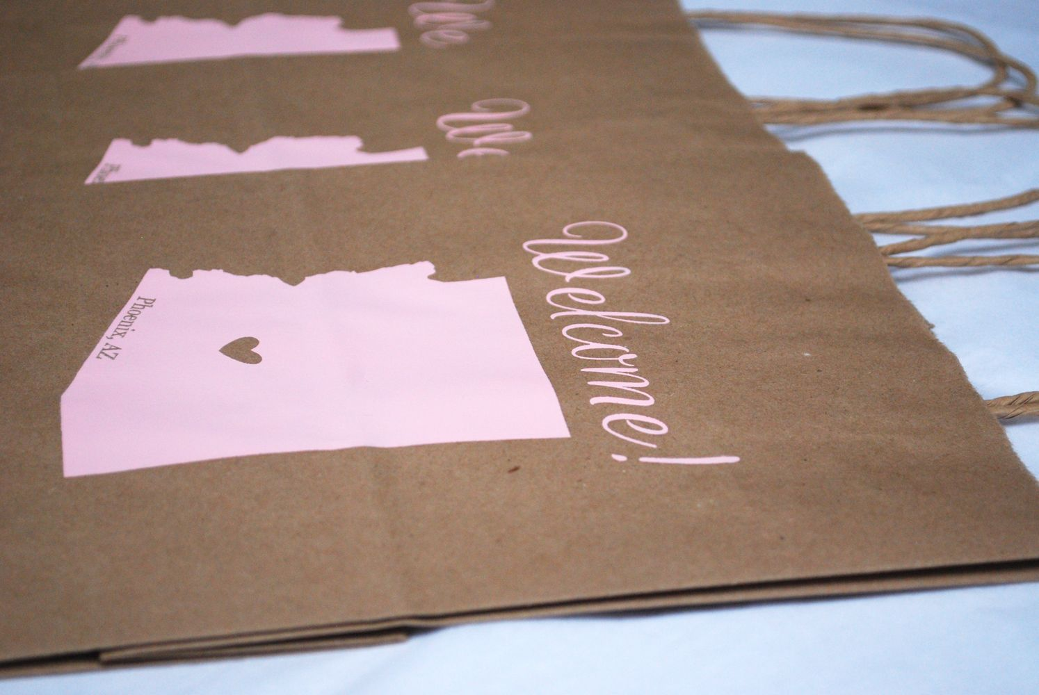 paper wedding welcome bags screen printed with state and message ...