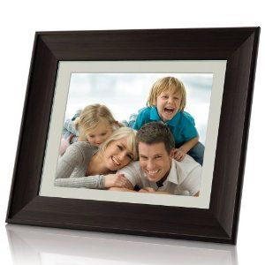 "Coby DP1052 10.4-Inch Digital Photo Frame with MP3 Player (Wooden Frame) by Coby. $84.41. From the Manufacturer                  Show off your photo memories with the DP1052 featuring a classic wooden frame and a vibrant 10"" LCD screen. Set your photos to music with MP3 audio playback and watch your favorite digital home videos. A full-size USB port and multiple memory card slots allow for quick and easy viewing. Integrated speakers, calendar and alarm clock functi..."