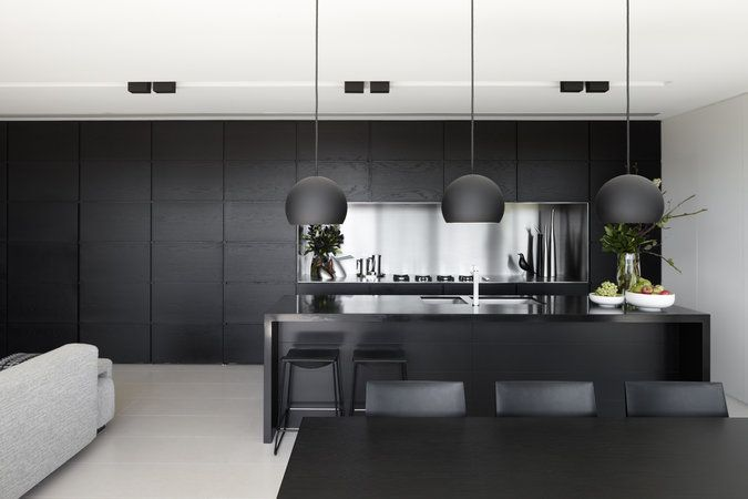 Delicieux Black Kitchen Stainless Steel Bench Top And Splashback. Black Stained  Timber Veneer Cabinet Cupboard Doors. Simple Black Pendant Over Dining  Table.