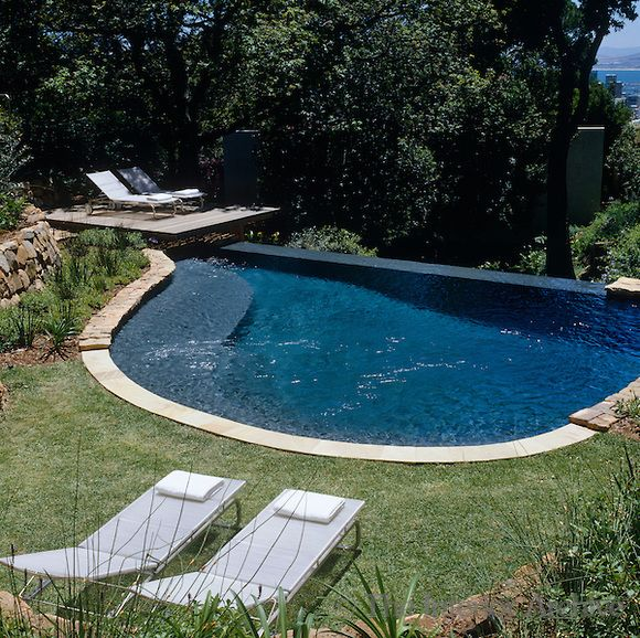 Sun Loungers Overlook The Semi Circular Infinity Pool With The
