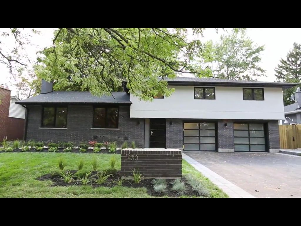 Modern take on a 60 39 s side split tons of curb appeal for Modern house exterior remodel