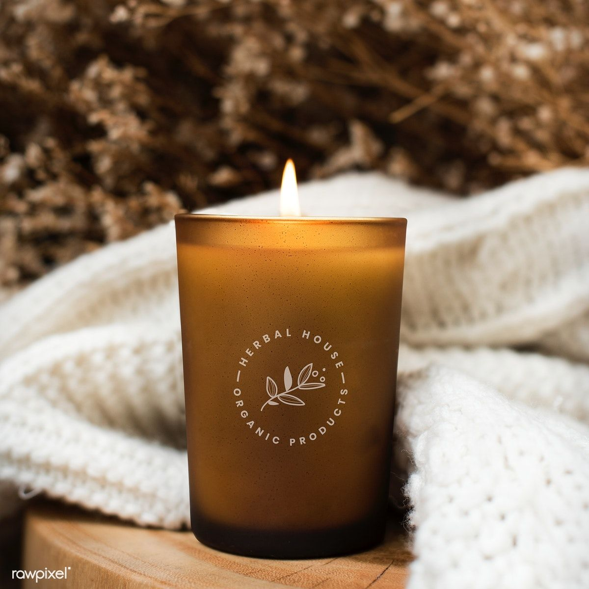 Aroma candle on a wooden table free image by rawpixel