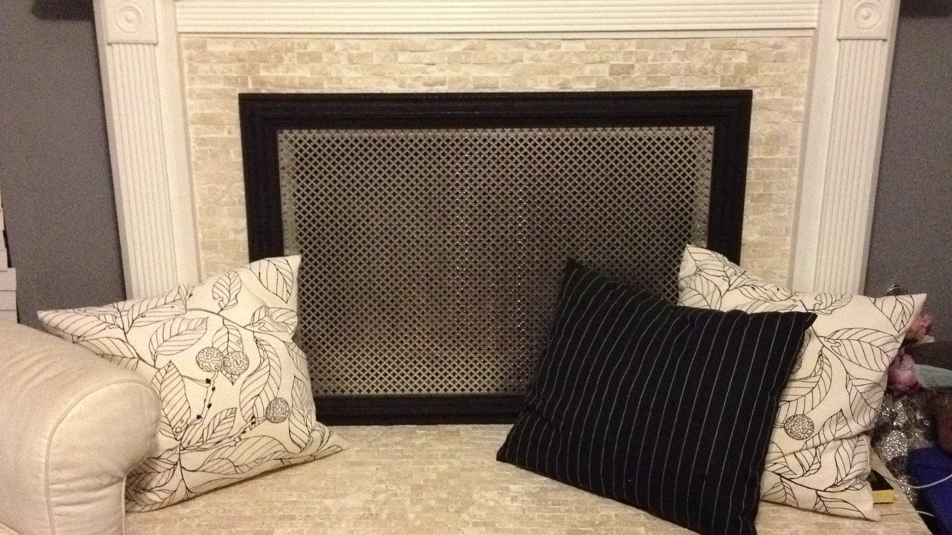 DIY decorative fireplace screen - drop a perforated aluminum sheet (I got mine from Home Depot) into a picture frame.  Hot glue where the metal meets the wood on the back and viol?!  Or how about smaller ones with hinges so you can move it about better.
