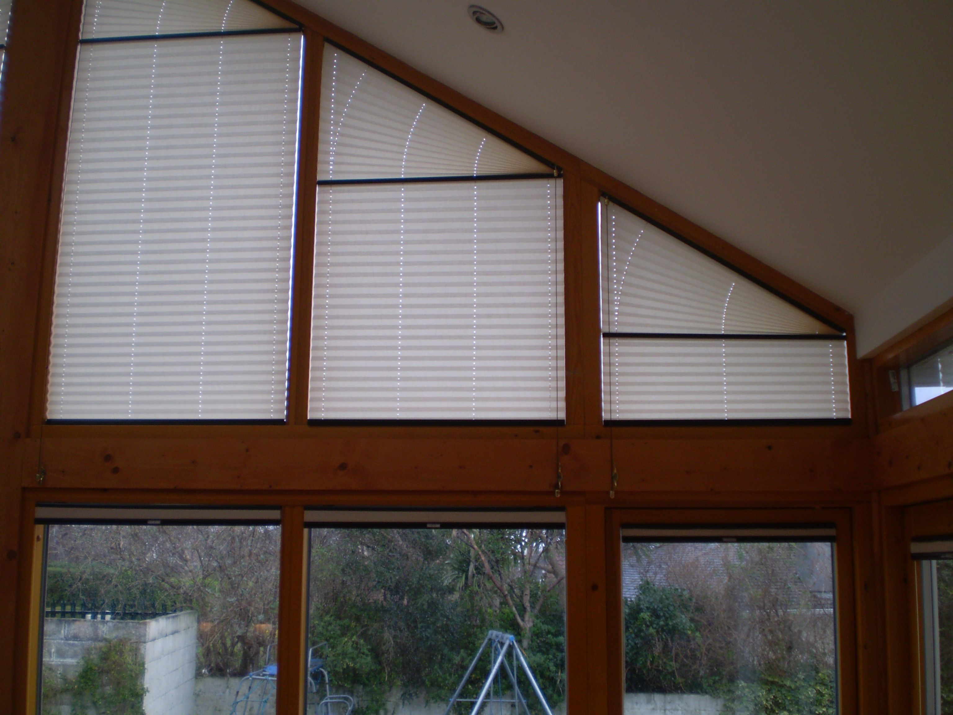 Shaped Pleated Blinds.  http://www.signature.ie/shaped-blinds.html