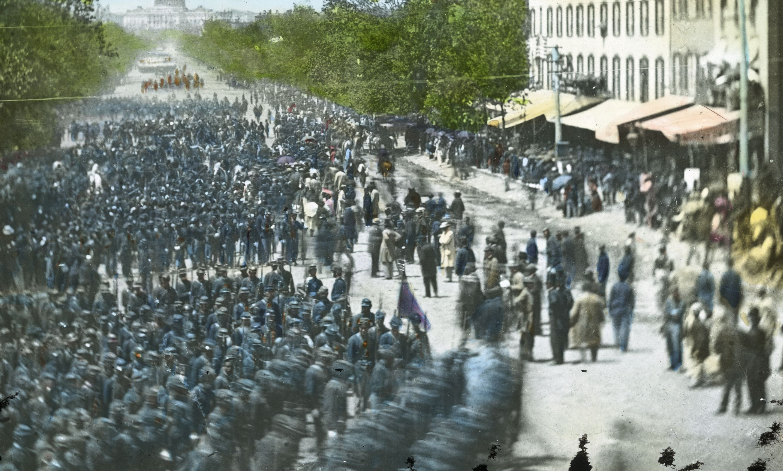 After four years of war, the Confederates surrendered to the United States in April 1865.  Pictured: the Union Army marches into Washington DC in 1865.