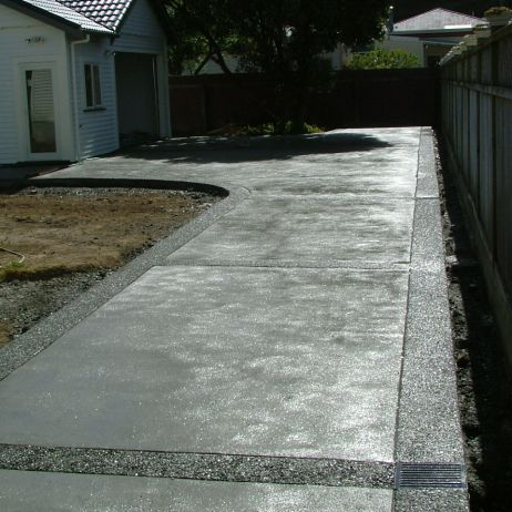 Break Up Concrete Mass With Exposed Aggregate Or Railway Sleepers