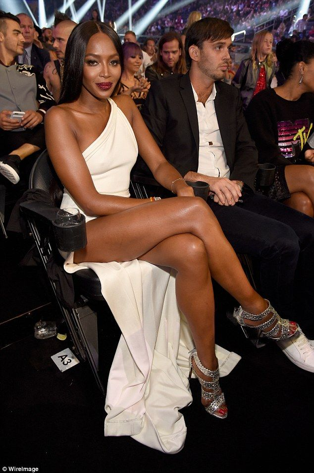 Poised: The star crossed her long legs as she sat in the audience...