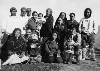 Description: Back row: Angutik, Isa Koperqualuk, Samisa, Mary Nuvalingaq and son, Alicie Pov, Leela daughter; Lucy and Markusie Qalinguk. Front row: Lydia Qupirrualuk, Lizzie Pov, unknown, Annie sister of Koperqualuk, Johnny Pov (Nuvalingaq) and son Allie. Location: Puvirnituq. Date: 1948? Photographer: Frederica Knight. Reference: IND-FK-037. Extent: B&W photograph. Credit: Frederica Knight.